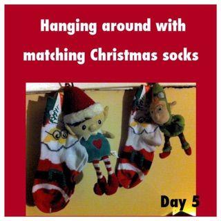 Elf on the shelf ideas Matching Christmas socks for both kids santa socks