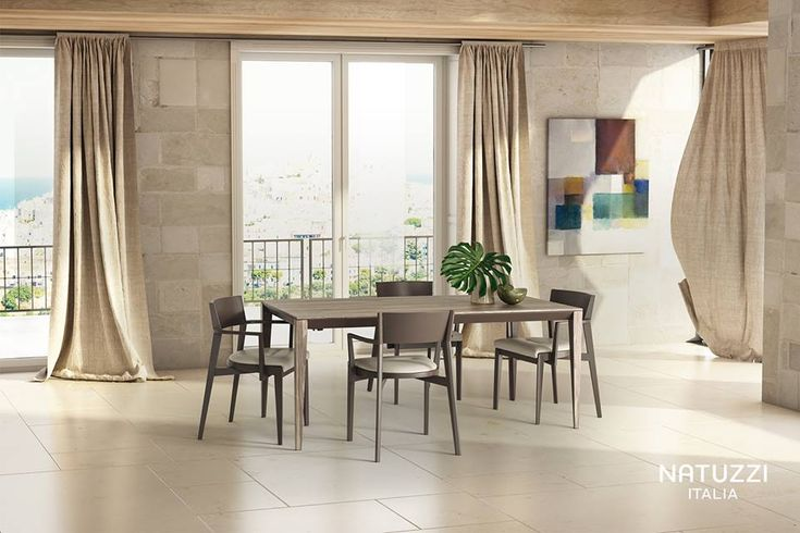 A slender table of great visual impact: Leggero is an outstanding expression of modernity and artisan skill, ideal to complete your living area.  #ItalianDesignerFurniture #LuxuryItalianDiningRooms