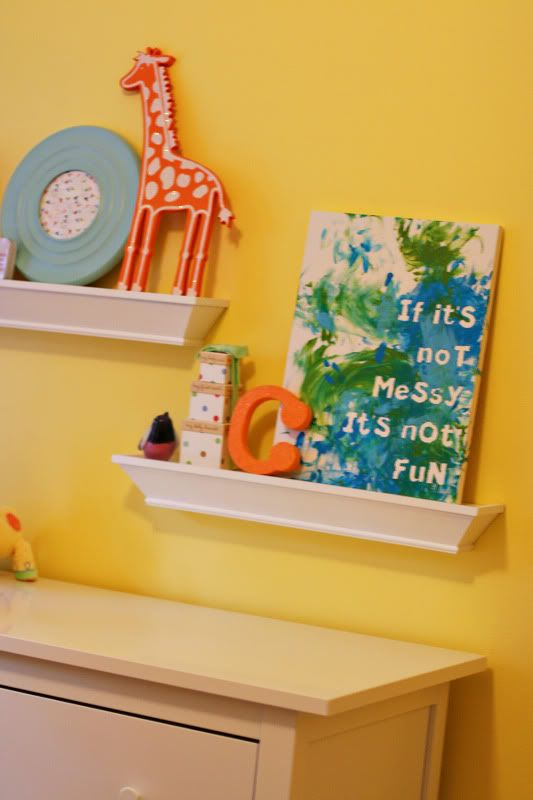 Take a painting canvas, put sticker letters on it, have kids finger paint on it, then remove the stickers!