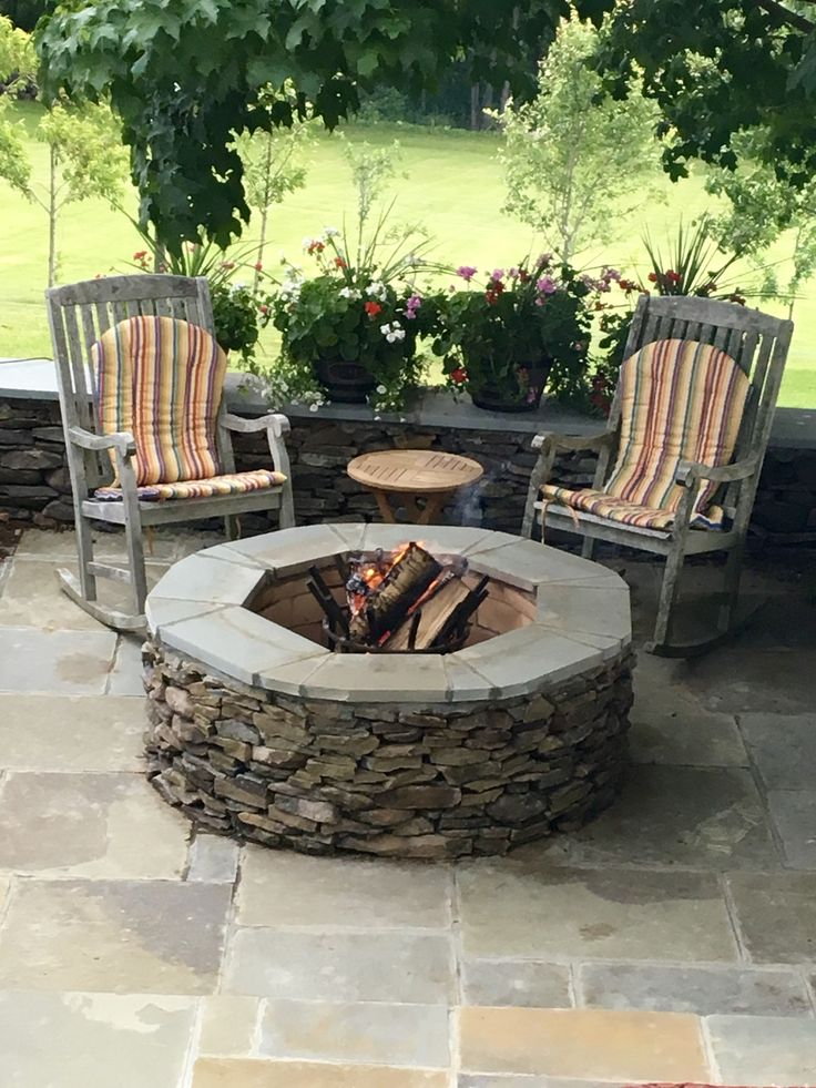 Large round natural stone masonry firepit Manufactured