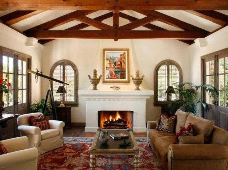 Mediterranean Style Decor With Casemen Windows With And Curve Top And  Shutter And Fireplace And Wall