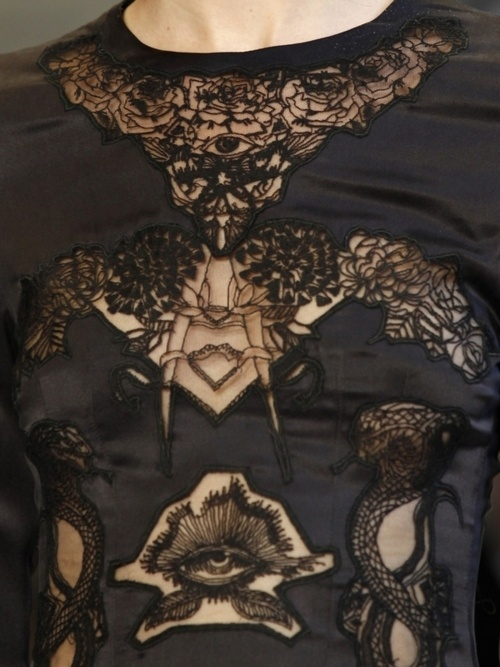 Freemason imagery in fashion, if you look closely...Baphomet head/horns, Freemason symbol, and an eye in a triangle.