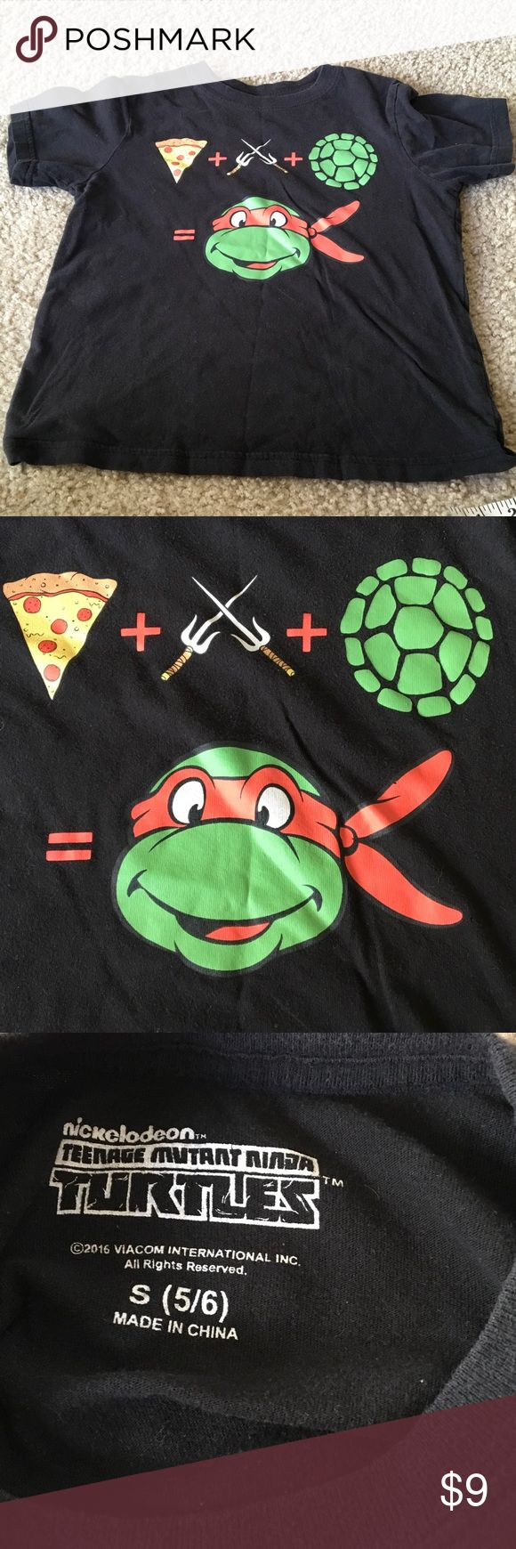 """NIckelodeon NINJA TURTLE TEE 🍕SMALL 5/6 cotton 🐢 NICKELODEON Solid black tee w NINJA pizza turtle, pizza & shell on front design. All intact. 💯% cotton and super soft. BLACK faded some IB+ condition. SMALL 5/6......14 3/4"""" underarm to underarm laying flat......18"""" top to bottom hem. 🐢🍕🐢🍕🐢🍕🐢🍕🐢🍕🐢🍕🐢🍕🐢🍕🐢🍕🐢 Nickelodeon Shirts & Tops Tees - Short Sleeve"""