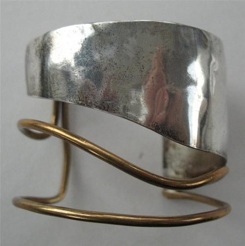 louis booth, mid century sterling & brass cuff. Louis L. Booth, Inc is a jewelry manufacturing, founded in 1983 by Louis Booth on Long Island, New York. Today Louis L. Booth, Inc. is one of the last remaining companies to design and manufacture costume jewelry domestically.