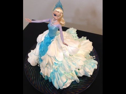 Elsa Doll Cake- Frozen- Cake Decorating - YouTube This is just beautiful! Love the tips she gives for creating movement/looking windswept