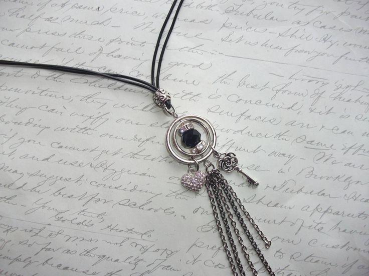 Long leather necklace with crystal pave heart and key charms and chain tassel de la boutique BijouxdeBrigitte sur Etsy