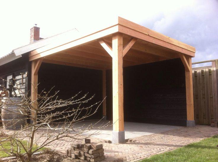 Overkapping van douglas hout op maat gemaakt met zwarte gepotdekselde wanden - Eigentijds pergola hout ...