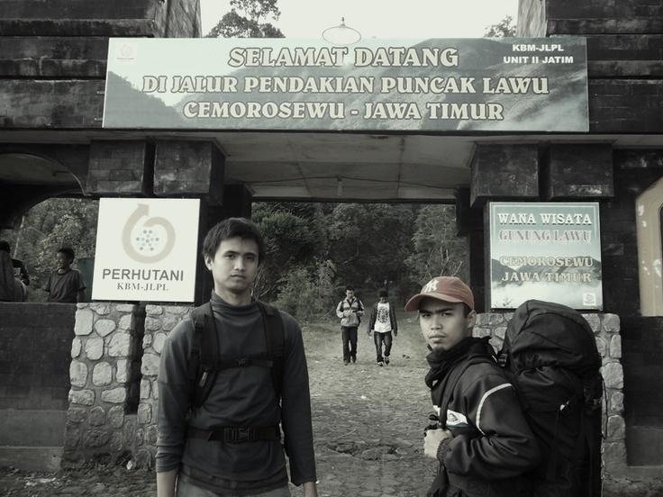 Reza & Banu are at front of hiking gateway, Cemoro Sewu, Magetan