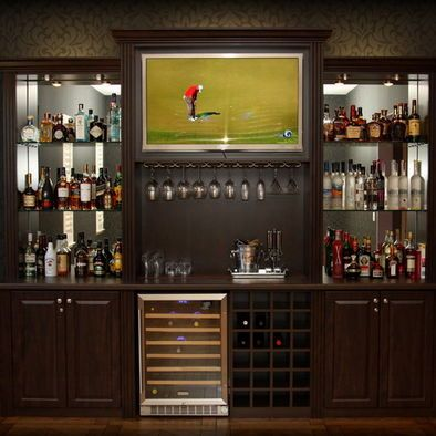 Built in bar idea - i like the idea of liquor shelves with mirror and glass, display liquor below and glasses above. wine rack next to or below