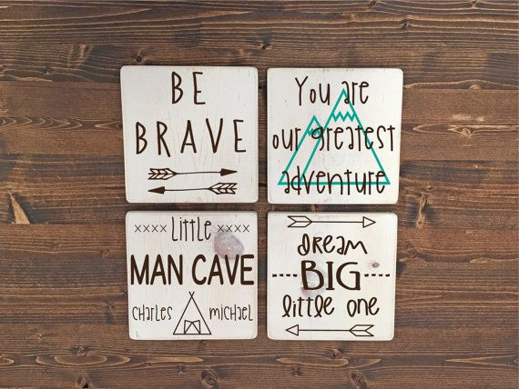"We've got your boy's room covered with this fun set of 4 wooden signs, including ""Be Brave"", ""You Are Our Greatest Adventure"", ""Little Man Cave"" and ""Dream Big Little One"", all in a mix of whimsical hand written typefaces and embellished with mountains, arrows and a tent. The ""Little Man Cave"" sign is even personalized with your child's name. Each sign measures 8"" w x 8"" h x ¾"" d and comes in your choice of 7 stain or paint finishes. All of our painted wood finishes are intentionally…"