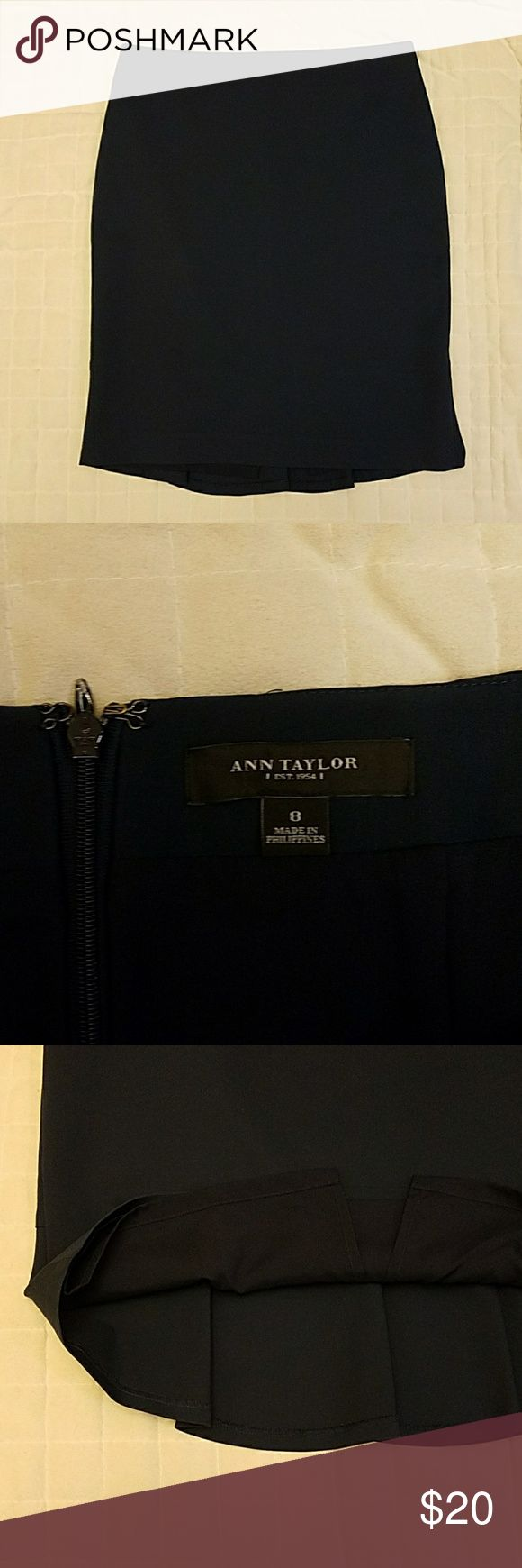 """Ann Taylor Navy Pencil Skirt Beautiful deep navy blue Ann Taylor pencil skirt.  Back boasts an adorable ruffle, adding little bit of fun to a classic wardrobe staple! Fabric is the kind of thick that equals quality; no show-through, no lines. Excellent addition to your work wardrobe!  15.5"""" top  19 """" waist 19"""" bottom 22"""" length  We are open to all reasonable offers! Ann Taylor Skirts Pencil"""