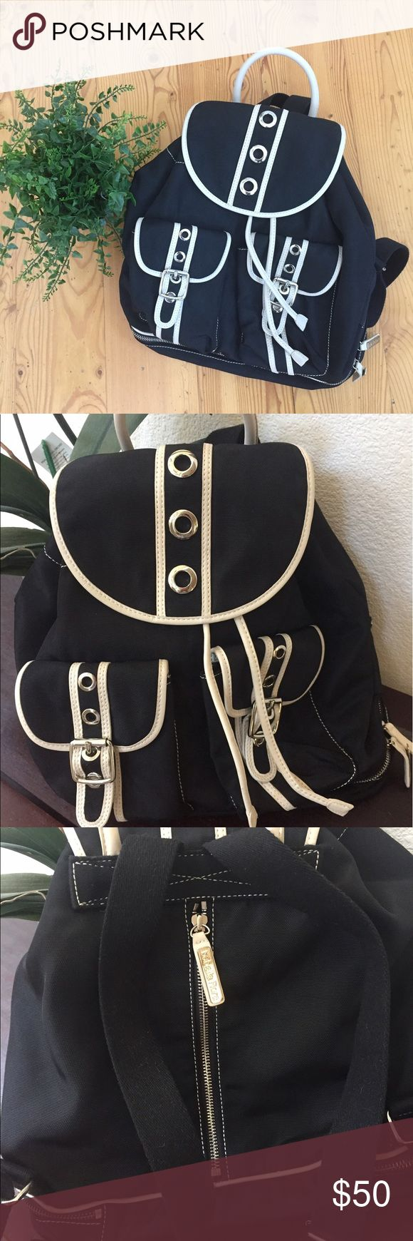 Isabella Fiore Black And White Backpack Pre owned, black and white leather adjustable drawstrings, black straps, clean inside , one defect on bottom side ( see pic), great quality bag! Isabella Fiore Bags Backpacks
