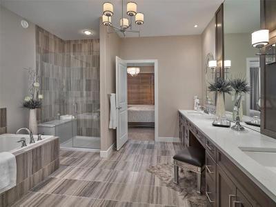 Amazing Master Ensuite! Tiled floor, tub & shower, extra long quartz vanity. Preston Master Ensuite Bathroom in the Keswick Villas Showhome | Kimberley Homes   #bathroom #bathroomdesign #bathroomidea #freestandingtub #vanities #interiordesign #newhomedesign #homedesign #newhome #customhome #yegre #buildwithkimberley #kimberleyhomes