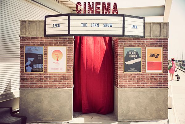 Old Cinema Photo Booth. Marquee and bulb letters. Vintage movie posters