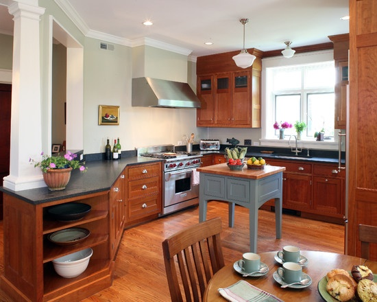 Soapstone Black Counters and keep wood cabinets unpainted- like better than painted white cabinets. LOVE grey countertops