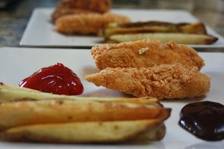 Gluten free crispy fried chicken strips with baked fries