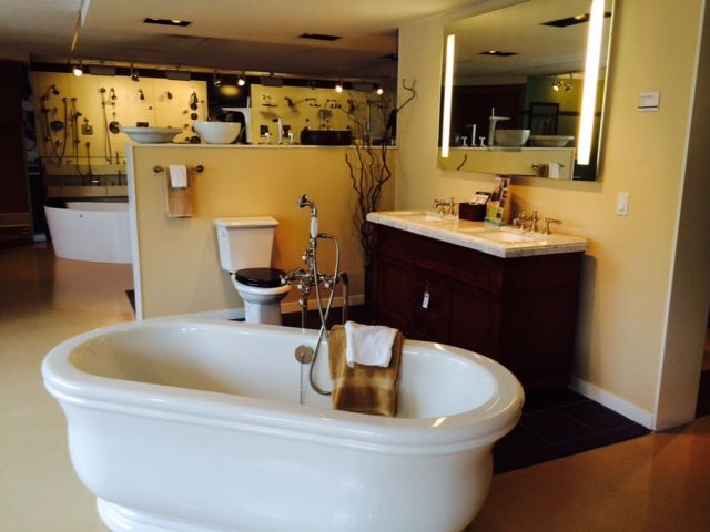 Americh Tub, Ronbow Vanity, Gerber Toilet, And An Electric Mirror W/ TV