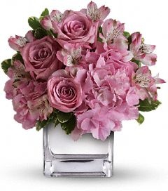 The beautiful bouquet includes pink hydrangea, lavender roses and pink alstroemeria accented with fresh greenery.