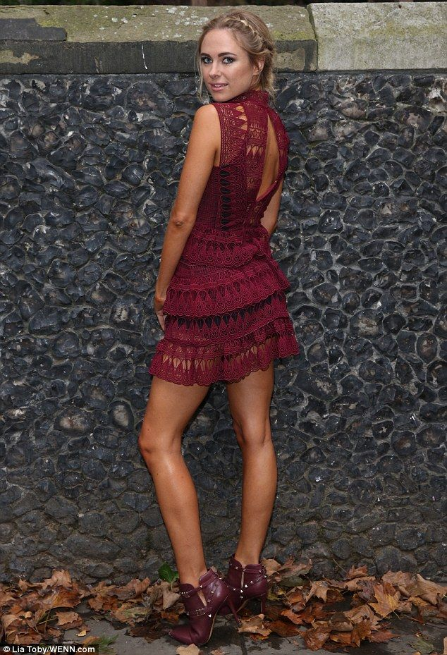 Dressed to impress: Kimberley Garner opted for a daring wine-coloured dress at thePPQ show for London Fashion Week at St Bartholomew the Great in West Smithfield on Friday