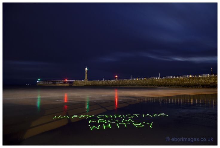 A little late evening light painting in the sand with a green laser pen.