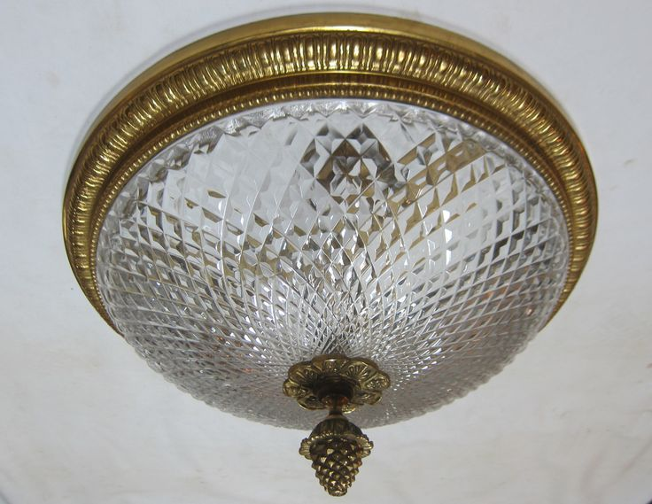 Pair of English close fitting ceiling lights in the original brass finish complete with period cut glass shades.  Priced for the pair. www.antiquelightingcompany.com