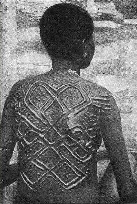Africa | The details of the scarification of a Yombe woman.  Congo | © H.A. Bernatzik.  Africa, 1947