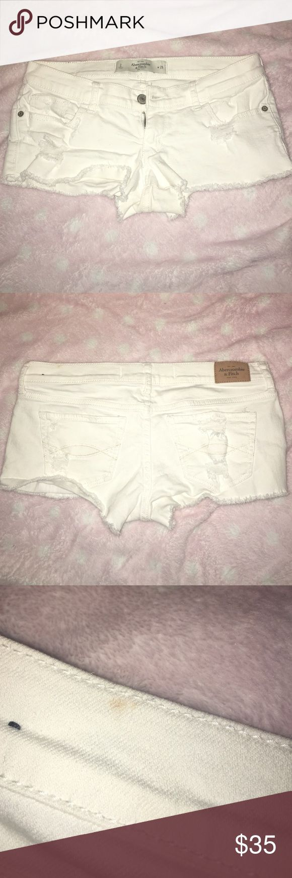 Abercrombie and fitch shorts bought these white denim shorts a while back and just haven't worn them, and they're far too short for me now! only worn two or three times, and in overall perfect condition aside from the very small brown stain on the top (pictured). make offers :) I do try ons, just ask !!! Abercrombie & Fitch Shorts Jean Shorts