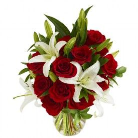 Though this bouquet of flowers is called the 'summer blooms bouquet', it is available year-round and the festive red and white flowers makes it a perfect gift for Christmas time! Beautiful white Oriental Lilies and red roses combine to make this one impressive, beautiful and long-lasting bouquet of flowers!White Flower, Red Rose