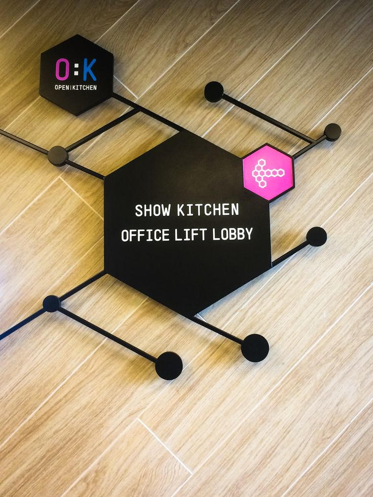 Hexa sign at show kitchen area directing to lift office for O:K (Open Kitchen)
