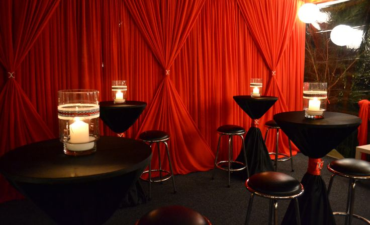 Cocktail function with red backdrop. Styled by Greenstone Events.