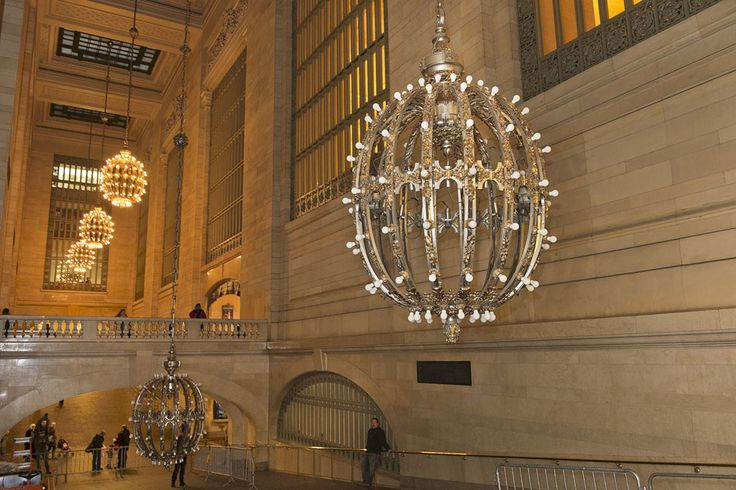 When these chandeliers were installed a century ago, they carried bare, energy-hungry incandescent bulbs. Today they use efficient compact fluorescent bulbs that use just 5 watts to provide the same amount of light as the previous 25-watt bulbs. Each chandelier holds 110 light bulbs. (Metropolitan Transportation Authority / Patrick Cashin)