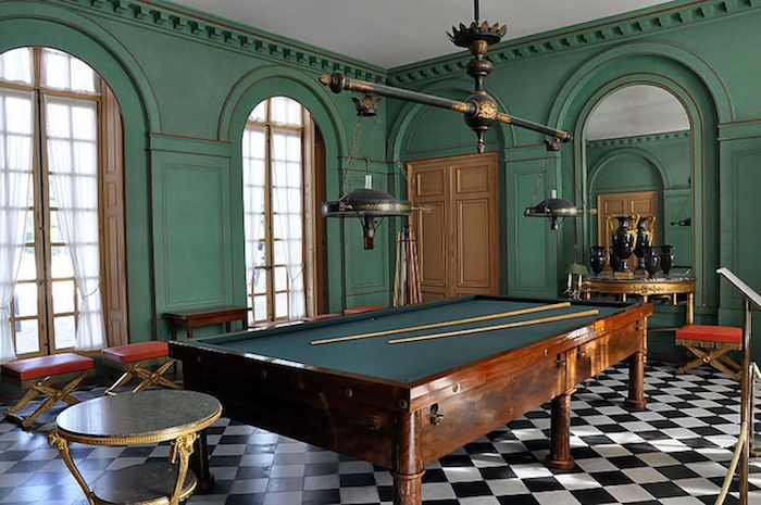 Located just outside of Paris, the Château de Malmaison dates to the 14th century, and was the former residence of Napoleon Bonaparte. The home's striking green billiard room was decorated in 1812 by Louis-Martin Berthault. Photo by Moonik.