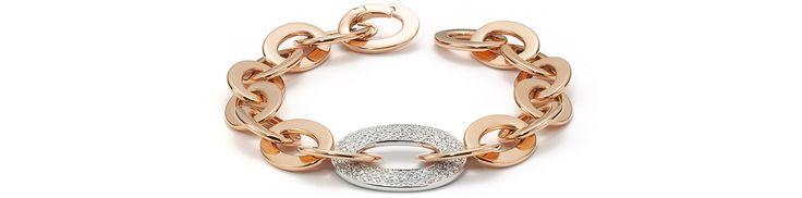 Une alliance d'or rose venant enlacer un maillon tout diamant, pour sceller une parure épurée.