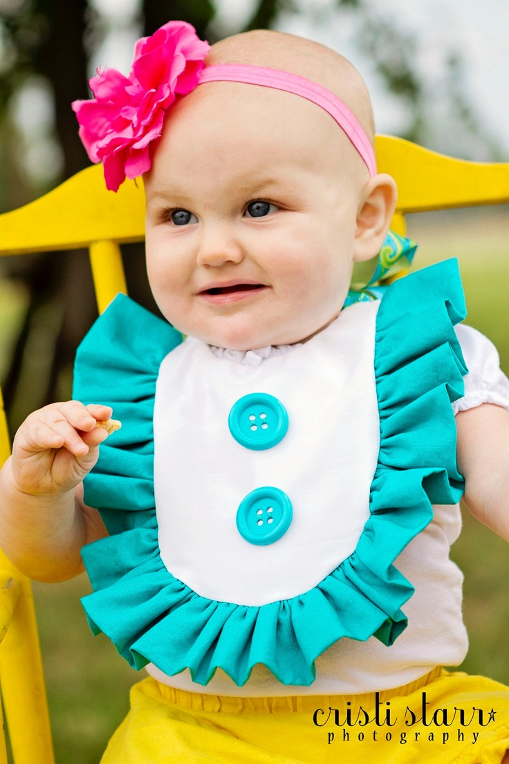 Baby BIB Cake Smash TEAL / Turquoise Aqua Ruffle Dress Bib for Baby - Retro, Colorful, Mod Buttons and Ribbon, First Birthday. $19.99, via Etsy.