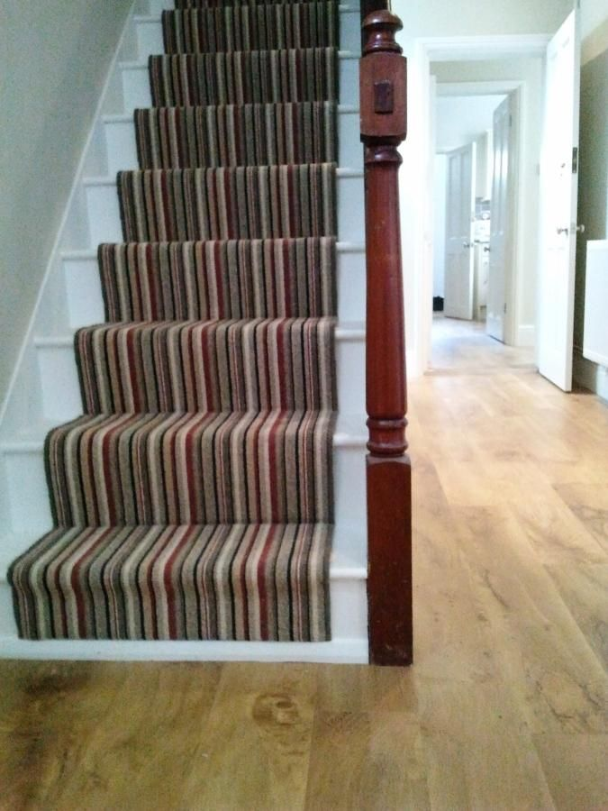 finelooking grey stripped carpet runner for stairs on white wooden foot stairs and brown laminate wooden floors inspiring indoor white living areas