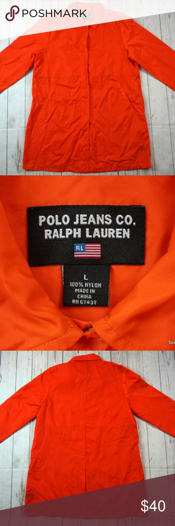 "Vintage Polo Sport Women's Rain Jacket Size Large Vintage Polo Sport Women's Rain Jacket Size Large, Orange, Full Zip & Button  Brand: Polo Sport Size: Women's Large Material: Nylon  Detailed Measurements: (Front Side of Garment has been measured laying flat on a table)  Sleeves:             25.5"" inches Chest:                21.5"" inches Length:                35"" inches  In good used shape and well cared for, ships in 1 business day or less from a clean and smoke free environment. Thanks…"