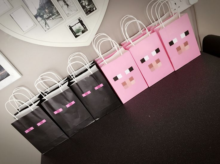 DIY minecraft party bags. Black Enderman for the boys and pink pigs for the girls.