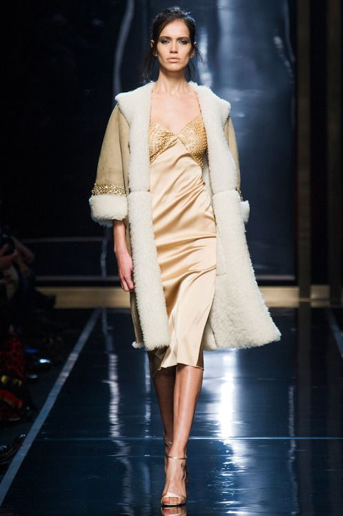 Ermanno Scervino RTW Fall 2014 - Ermanno Scervino melded lingerie with outerwear in his fall collection, which he described as a meeting between couture and technical elements. This silk dress immediately reminds lingerie wear.