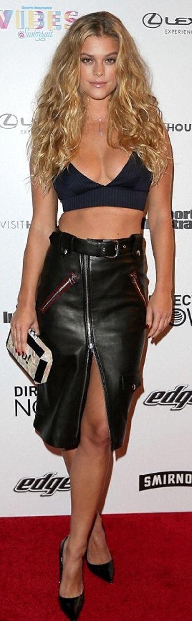 Who made Nina Agdel's black crop top, leather skirt, clutch handbag, and pumps?