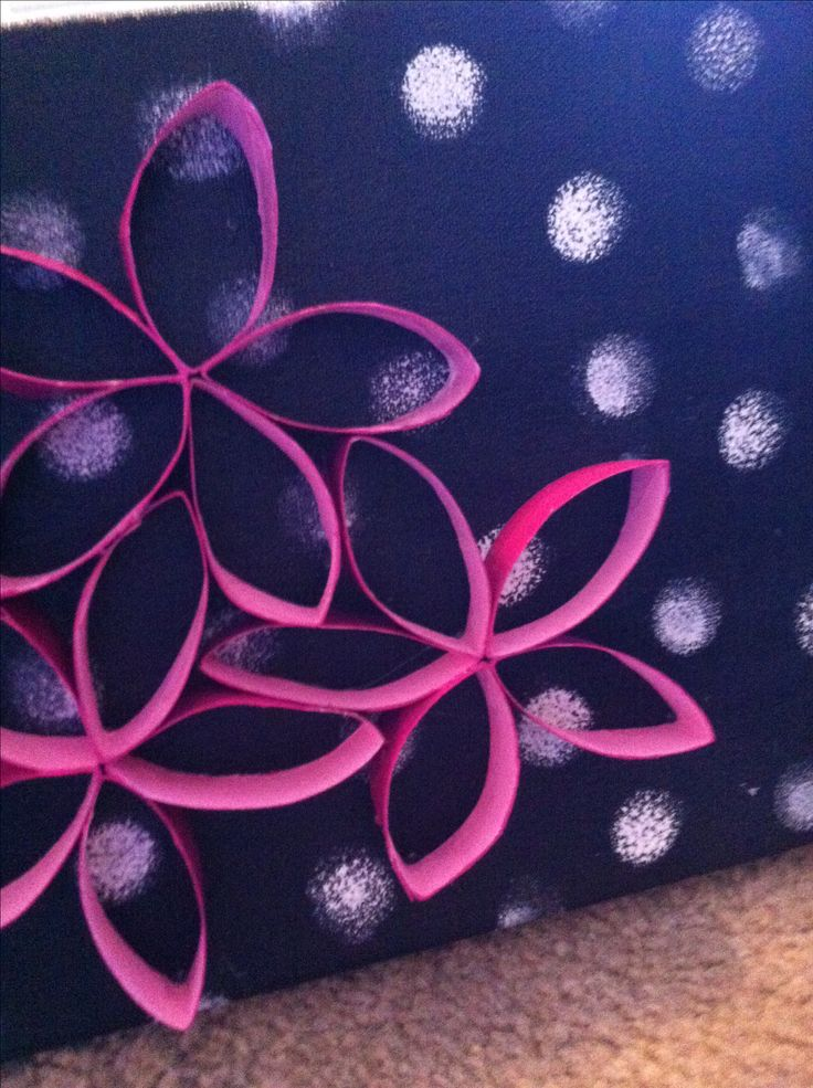 A fun canvas art with toilet paper rolls! Good idea for college dorm room decor and cheap craft! :)