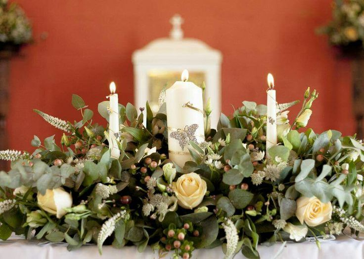Church flowers on alter. #weddingflowers #peachroses #candle #butterflybrooch #alterflowers #churchflowers #weddingcandles #happiestdayofmylife #peachwedding