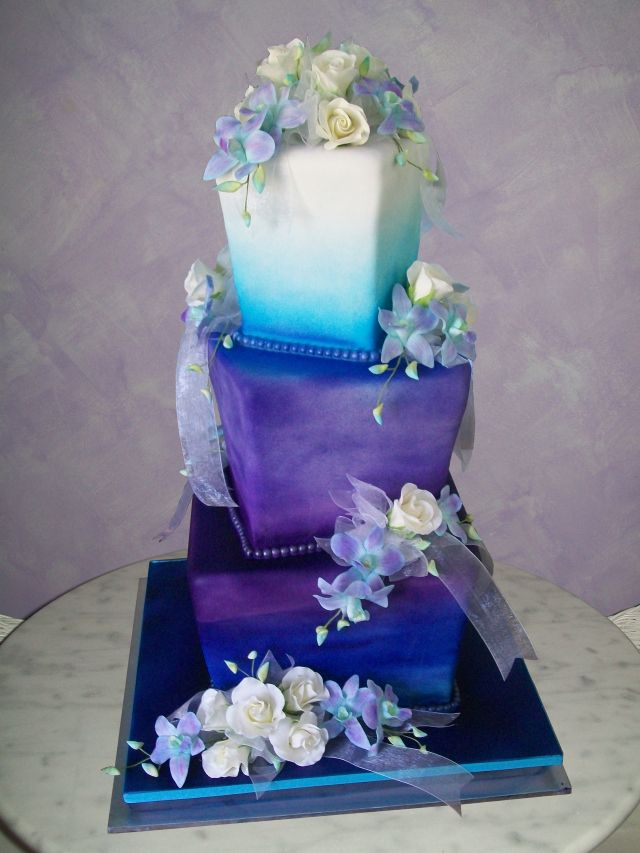 Purple and blue wedding cake, I like this without the flowers, if there had to be some flowers id want white roses