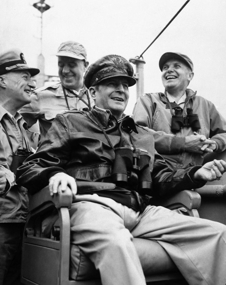 Gen. Douglas MacArthur, commander-in-chief of United Nations Forces, on the bridge of the USS McKinley on his arrival at Inchon Harbor in September, 1950. Standing left to right are: Vice Admiral Arthur D. Strubble, Commander of the U.S. Seventh Fleet; Brig. Gen. E.K. Wright, Assistant Chief of Staff, G-3 Far East command and Major Gen. Edward M. Almond, Commanding General, 10th corps.