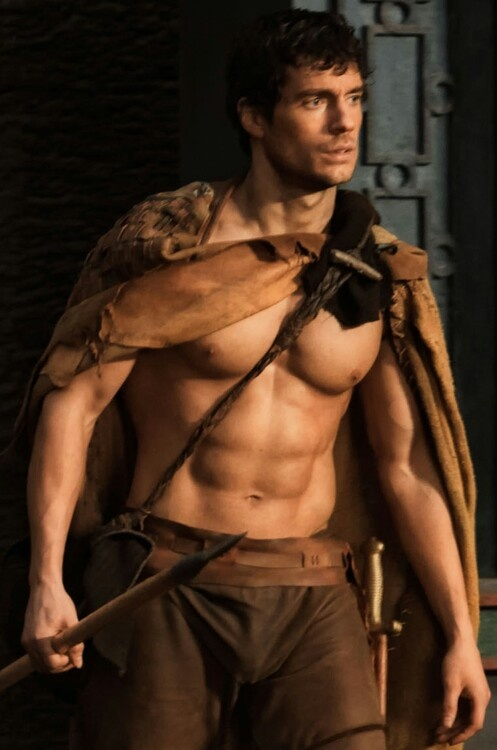 man pecks.. manly man wash board abs.... beautiful man face... i'd have to guess it is henry cavill
