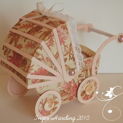An old fashioned pram for a Baby Girl.3D paper crafts made by Inger Harding