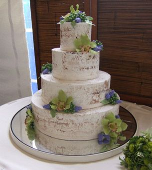 Brides Magazine: Fall Wedding Cakes : Wedding Cakes Gallery  White chocolate ganache is dusted with cocoa to create the faux-bois birch bark-like exterior. The finishing touches: gumpaste cymbidium orchids, wildflowers, and berries to accent each tier. Cake by Something Sweet by Michelle