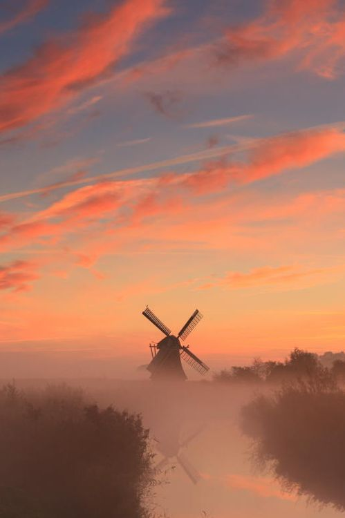 Dutch windmill underneath Dutch sky.  Gorgeous!  We lived in Holland for 5 years and loved visiting the windmills!