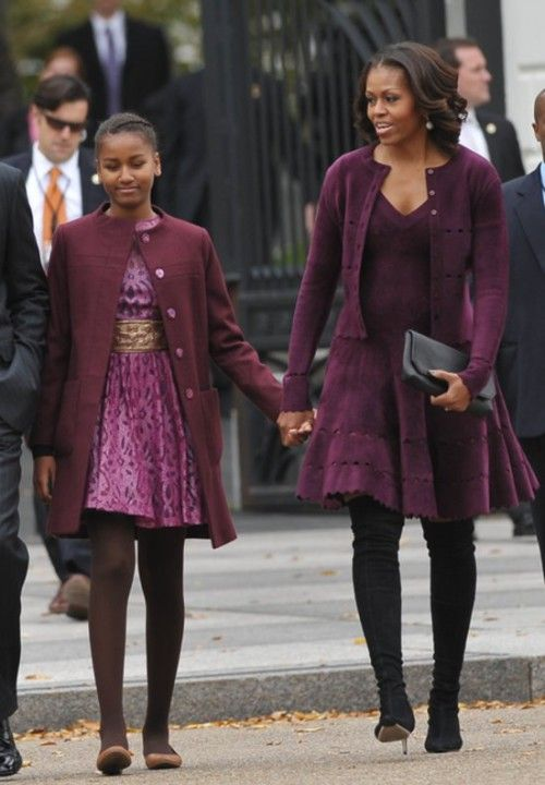 First Lady Michelle Obama walks with First Daughter Sasha. <3 the coordinated eggplant dresses.