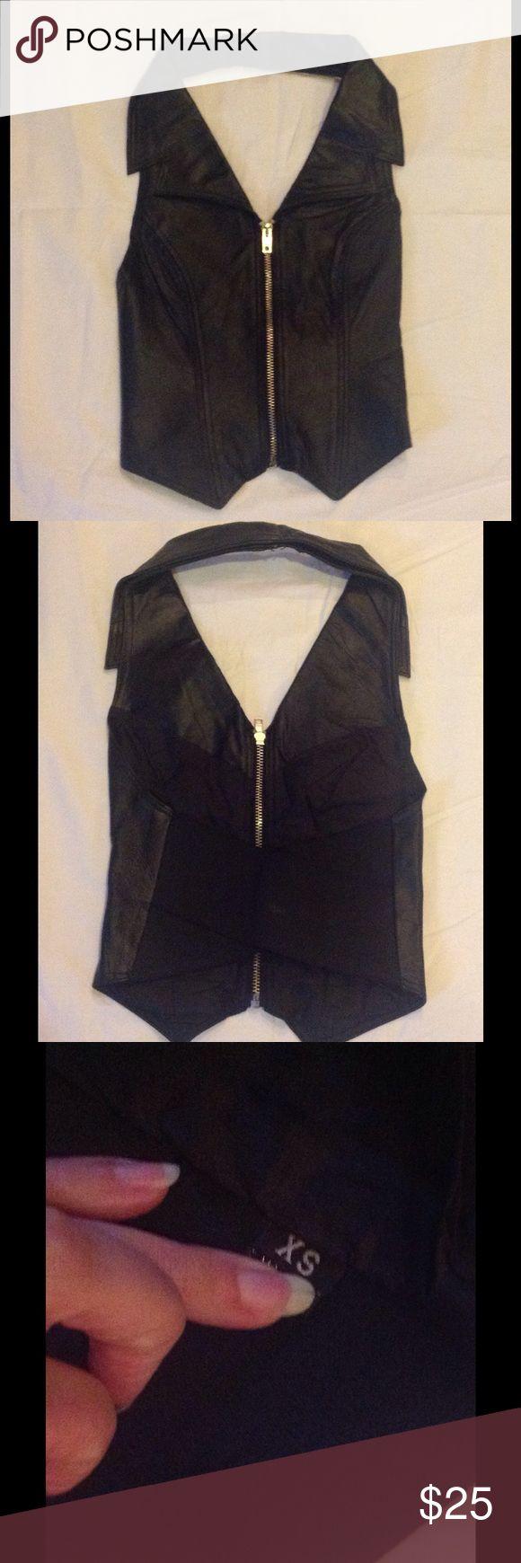 Black leather biker vest XS Black leather biker vest XS There is no tag so I can't say if it's real leather or not. Open back with elastic... Harley-Davidson Jackets & Coats Vests