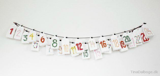 Lav pakkekaldender til jul med papirposer. Brug masking tape til at skrive tal med. Køb materialer i Kreahobshop.dk